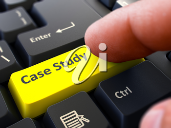 Case Study Button. Male Finger Clicks on Yellow Button on Black Keyboard. Closeup View. Blurred Background.