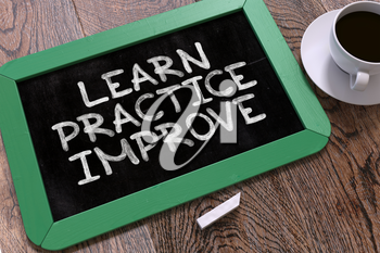 Learn Practice Improve. Green Chalkboard on Wooden Table. Business Background. Top View.
