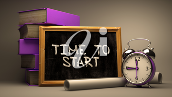 Time to Start - Chalkboard with Hand Drawn Text, Stack of Books, Alarm Clock and Rolls of Paper on Blurred Background. Toned Image.