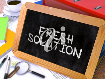 Fresh Solution - Chalkboard with Hand Drawn Text, Stack of Office Folders, Stationery, Reports on Blurred Background. Toned Image. 3d Render.