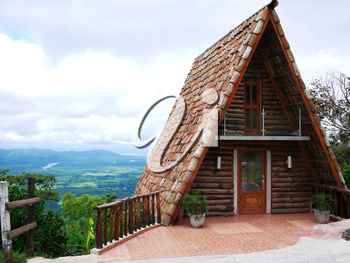 Royalty Free Photo of an A-Frame Cabin on a Mountain