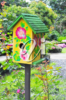 Royalty Free Photo of a Birdhouse in a Garden