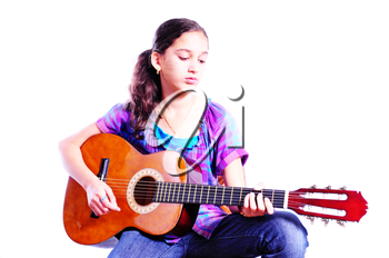 Young girl playing a guitar isolated on white