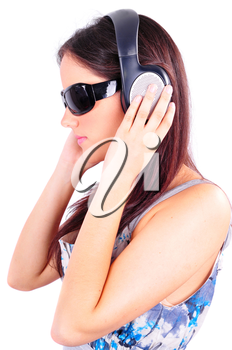Profile of young girl with sun glasses listening to music on headphones isolated on white