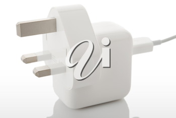 White electric plug on a hite background with reflection