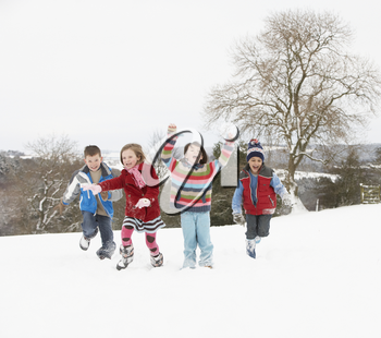 Group Of Children Having Fun In Snowy Countryside