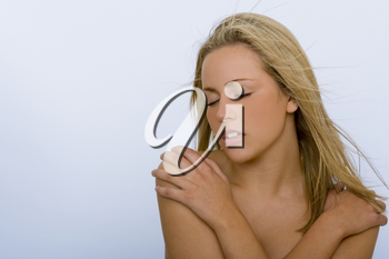 Studio shot of a stunningly beautiful young blond woman with eyes closed with an ecstatic expression