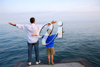 Father and son on a pier relaxing together