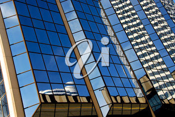 Reflections in a blue mirror glass wall of a skyscraper abstract background