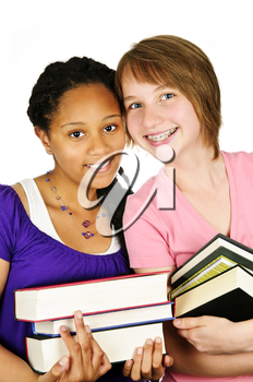 Isolated portrait of two teenage girls holding text books