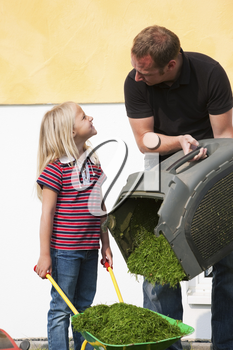 Father and daughter mowing lawn together