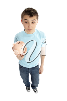 A boy in blue t-shirt and jeans holding a ;piggy bank money box