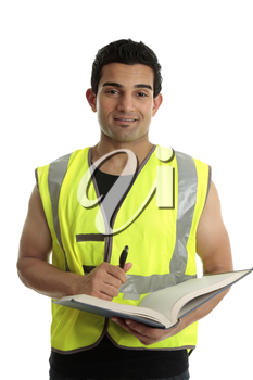 A male construction worker or other labourer holding a book and pen.  He is looking up and smiling.  White background.