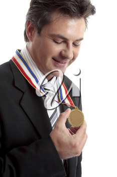Business awards.   Businessman admires his gold medal