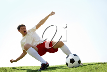 Portrait of soccer player on football field