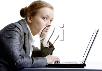 Thoughtful businesswoman with laptop near by over white background