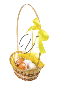 Image of Easter theme with basket full of colored eggs over white background