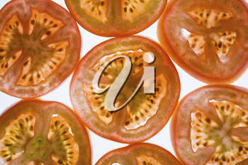 Image of several fresh slices of tomato