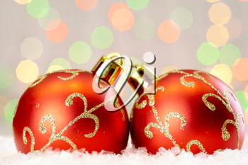Red Christmas baubles with golden decor against glaring background