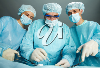 Portrait of three surgeons standing surprised