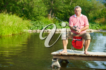 Photo of senior man fishing on weekend