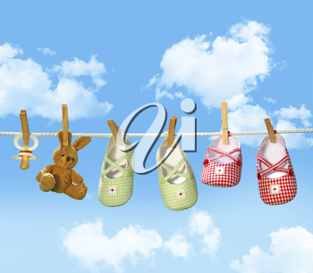 Royalty Free Photo of Baby Items on a Clothesline