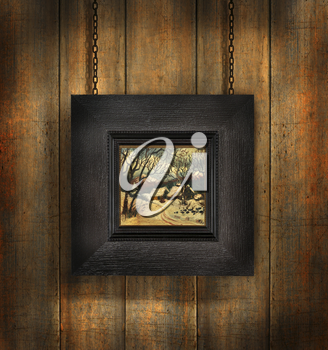 Royalty Free Photo of a Dark Wood Picture Frame Against a Wood Wall