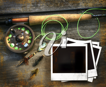 Royalty Free Photo of a Fly Fishing Rod and Polaroids