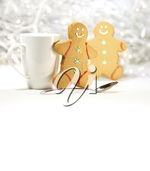 Royalty Free Photo of a Cup, Spoon and Two Gingerbread Men