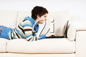 cute woman on her couch with her laptop