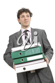 Tired young businessman carrying stack of folders. Isolated on white.