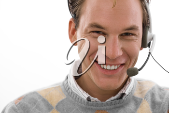 Smiling male customer service operator in headset, white background.