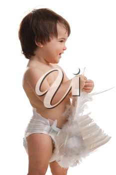 Happy baby girl wearing diaper, holding white angel wings, laughing. Isolated on white background.