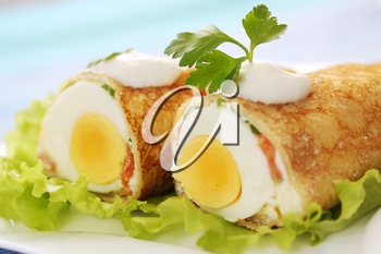 pancake stuffed with egg and salmon with sour cream