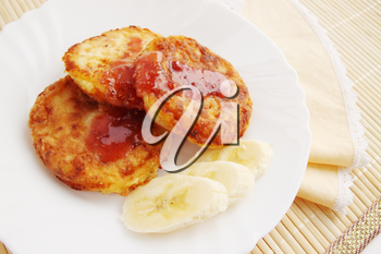 Roasted pancakes with raspberry jam and a banana