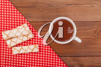 Cup of tea and sweet cookies on the table.