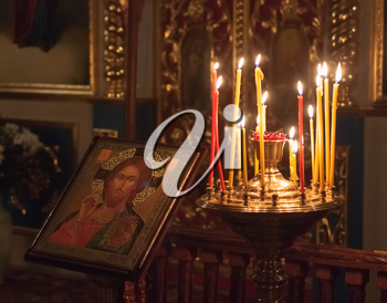 GOMEL - MAY 4: Interior Of Belarusian Orthodox Church. Candles Under The Ancient Icon Framed With The Gold On May 4, 2013 In Gomel, Belarus