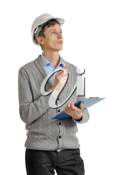 builder in a white protective helmet and with a clipboard looks upward and thinking. isolated on white