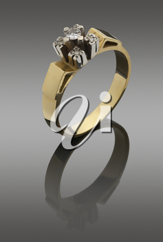 womanish  ring of pure gold with diamonds. with clipping paths