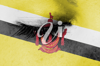 Crying woman, pain and grief concept, flag of Brunei