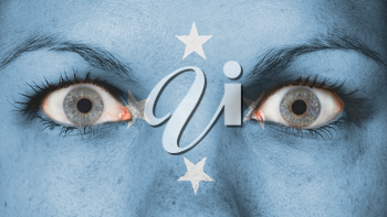 Close up of eyes. Painted face with flag of Micronesia