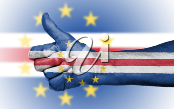 Old woman giving the thumbs up sign, isolated, flag of Cape Verde