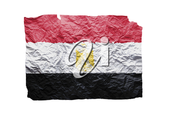 Close up of a curled paper on white background, print of the flag of Egypt