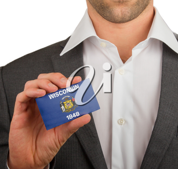 Businessman is holding a business card, flag of Wisconsin