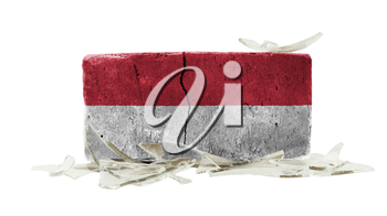 Brick with broken glass, violence concept, flag of Indonesia