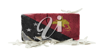 Brick with broken glass, violence concept, flag of Papua New Guinea
