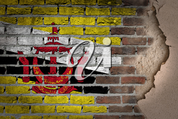 Dark brick wall texture with plaster - flag painted on wall - Brunei