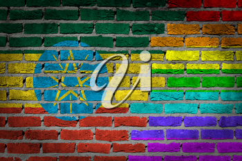 Dark brick wall texture - coutry flag and rainbow flag painted on wall - Ethiopia