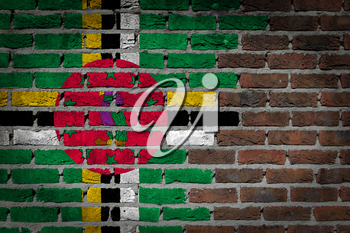 Very old dark red brick wall texture with flag - Dominica