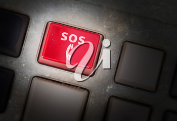 Red button on a dirty old panel, selective focus - SOS